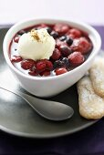 Frozen berries in honey syrup with mascarpone ice cream