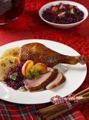 Roast goose leg with accompaniments for Christmas