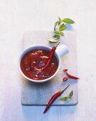 Chilli sauce in a small dish