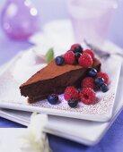Chocolate truffle cake with fresh berries