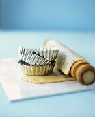 Tartlet tins and rolling pin with savoury shortcrust pastry