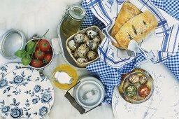 Tomatoes, milk jug, cheese balls, spinach pasties, quails' eggs