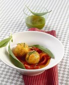 Crispy sheep's cheese dumplings with ramsons on marinated peppers