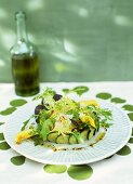 Raw sea bream salad with courgette flowers