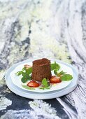 Chocolate mousse with peppermint salad and strawberries