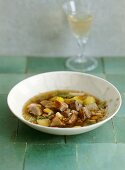 Barley stew with confit of goose