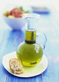 Olive oil and a piece of bread