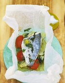 Sea bass with tomato and fennel cooked in parchment paper