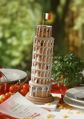 A table laid for an Italian meal (The Leaning Tower of Pisa as a centre-piece)