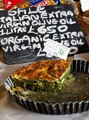 Ricotta spinach pie in baking dish at a Farmer's Market in England