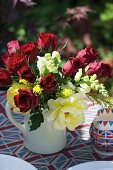 A bunch of roses on a patriotically British table