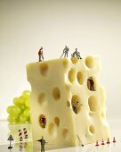 Holey cheese with construction worker figures
