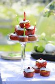 A cupcake pyramid with birthday candles