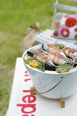Mackerel wrapped in bacon on the barbeque