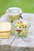 Avocado salsa with sesame seeds and crackers