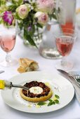 Goats' cheese tartlet with olive oil