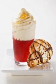 Mulled wine topped with cream and a chocolate crostini