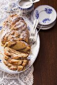 Hefe-Nusszopf (sweet yeast bread with nuts) with icing sugar