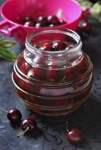 A jar of preserved cherries
