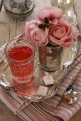 Fruit tea and a bouquet of faux roses