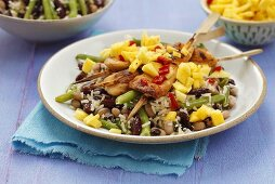 Rice with beans, chicken kebabs and mango