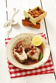 Hake with almonds and raisins in red wine sauce (Poland)