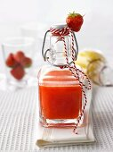 Home-made strawberry liqueur to give as a gift