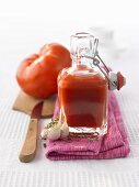Home-made tomato ketchup in glass bottle