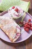 Soufflé omelette with raspberry cream