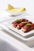 Involtini di carpaccio (Beef rolls with cheese filling)