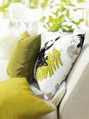 Cushions and books on a sofa