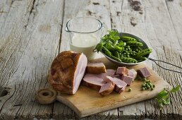 Ham and peas on a wooden board