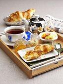 Breakfast: tea, fruit salad and croissants