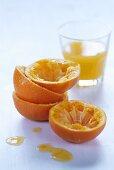 Squeezed orange halves and freshly squeezed orange juice