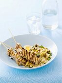 Grilled fish kebabs with orange and ginger, couscous