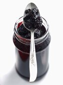 Blackberry and elderberry jelly in jar with spoon