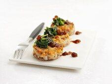 Salmon fish cakes with raisin sauce