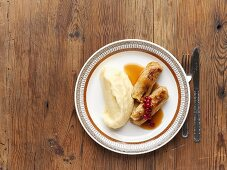 Stuffed cabbage leaves with mashed potato & cranberry compote