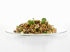 Cereal salad with onions, hazelnuts and beetroot leaves