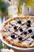 Onion pizza with anchovies and black olives