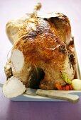 Roast turkey on vegetables