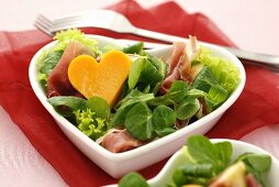 Salad leaves with ham and cheese heart