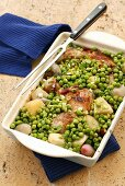 Baked chicken, potatoes, shallots and peas