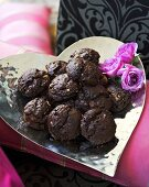 Chocolate biscuits on heart-shaped silver plate