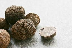 Black truffles (Chinese truffles) whole and halved