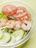 Salad leaves with cucumber, tomatoes and prawns to take away