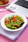 Spinach and strawberry salad with balsamic vinegar, notebook