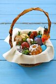 Easter eggs, sausage and baba in basket (Poland)