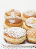 Assorted doughnuts on paper plate