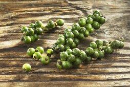 Green pepper on wooden board